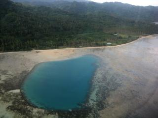This calm, sandy Swimming Lagoon is a 5-10 minute walk down the beach from SigaSiga