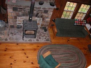 Stone hearth & wood stove from the upstairs balcony