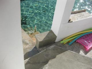 Walk down the steps into the crystal clear Bahamian waters from your patio
