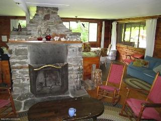 Main room with fireplace; the wood stove and dining table are on the far side of the  fireplace.
