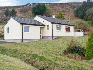 TAIGH AN TOBAIR (HOUSE BY THE WELL), detached cottage, with stunning views, wood
