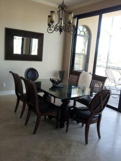 Breakfast area is open to kitchen behind with 4 barstools.