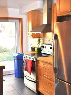 the kitchen offers a view on the backyard. Great for having an eye on the kids while you cook!
