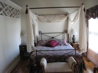 Lovely Queen bed in the cottage.