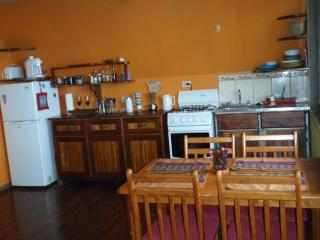 Fully equipped kitchen with large picture windows overlooking the Gulf and mountains