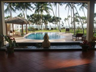 Luxurious 4 bedroom beach front villa, pool,staff