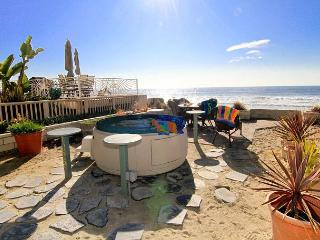 Condo on the Beach w/ oceanfront balcony and patio,Designer Decorated