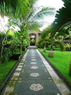 Walkway through beautiful tropical garden towards The Studios.