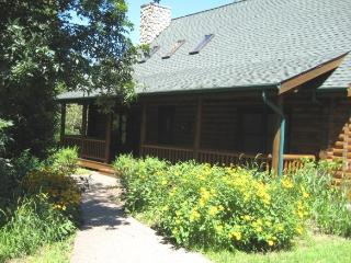 BEAUTIFUL LOG HOUSE- 3 BDRMS- 3 1/2 BATH- POOL TABLE- OUTDOOR HOT TUB