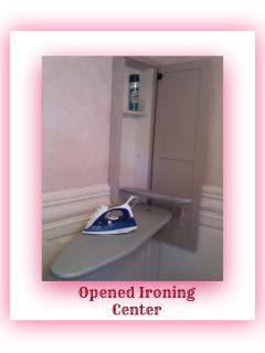 Built in Ironing Center/ open & ready to go.