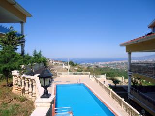 2 bedroom condo: garden, pool and magnificent view