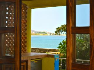 View of Bay through French Doors in Master