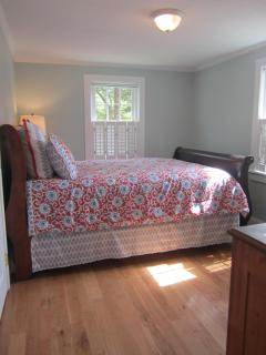 Front bedroom with queen size bed.