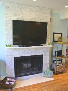 Beautiful limestone gas fireplace with 47' HD TV, Bluray player
