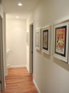 The upstairs hallway with vintage Disney artwork
