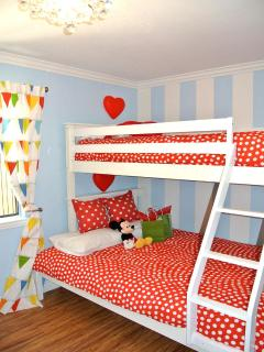 The kids bunk bed with twin on top, full on the bottom, twin mattress on the floor - can sleep 4