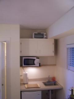 Kitchenette with toaster oven, microwave