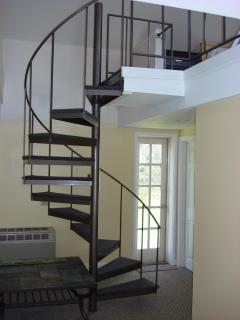 Spiral staircase leading to loft bedroom 1