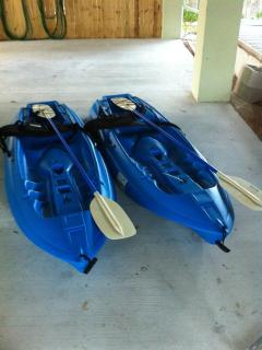 two single person kayaks ready to launch