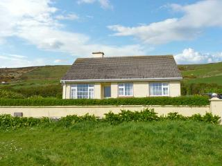 ST FINIANS BAY COTTAGE, a single storey, detached cottage, with open fire, and lawned gardens, in Ballinskelligs, Ref 15299