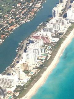 The building is the one on the top right (beach side) next to the small round building