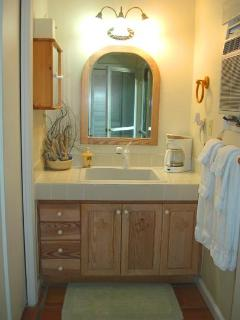 Separate and convenient vanity area adjacent to the bathroom.