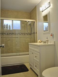 Bathroom comes with hand and bath towels for your convenience.