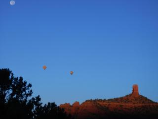 Chimney Rock with hot air balloons rising in the early morning. Hike around Chimney Rock is great!
