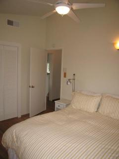 Master with king size bed & ceiling fan.