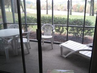 looking out at screened porch and golf course