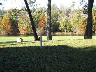 View of golf course and creek from screened porch
