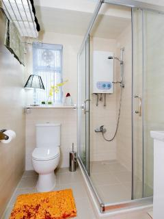comfortable walk-in shower with reliable water pressure and hot water