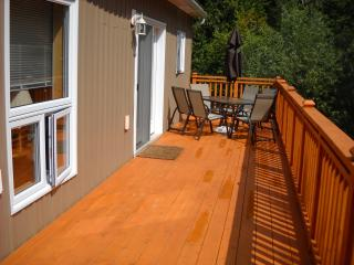 Cedar Deck around Cottage with Patio Furniture