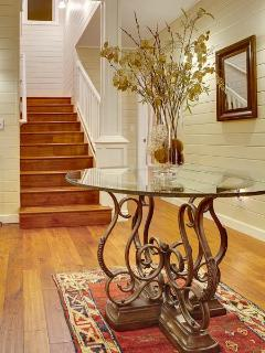 Rotunda in entry area.  Walls are all painted T&G pine, evoking a timeless Cape Cod beach house.
