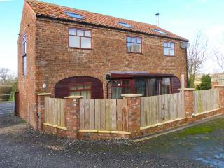 THE BARN, woodburning stove, upside down accommodation, working farm in Burton F