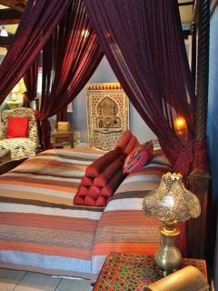 King bed with tent canopy, Moroccan fountain, ambiance lighting