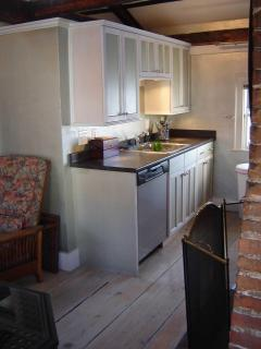 Full kitchen with dishwasher, oven, refrigerator, microwave