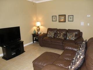 Open and flowing living room with comfortable sofas, cable and flat screen TV