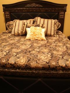 King bed in bedroom on main level.