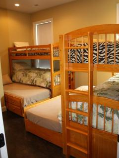 Bunk bed room on main level. Two triple bunks with 6 twin beds, sleeps 6.