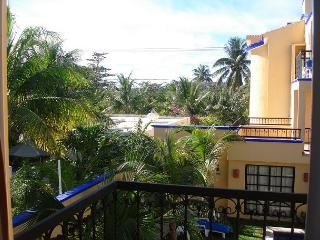 Balcony overlooking the pool, peaceful apartment with great amenities