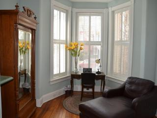 Chaise lounge, armoire and desk in bedroom