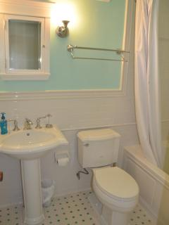 Bright Bathroom with Tall Ceiling