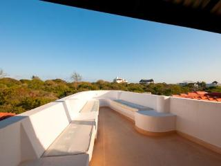 At the top of the house is a roof terrace open to the elements