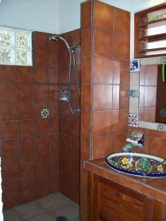 Downstairs bathroom with Talavera sink. This is a complete bathroom with hot shower.