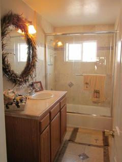 Full bath, stone and tile