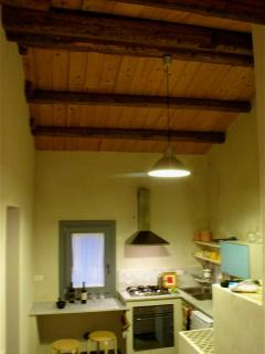 Kitchen with exposed wood beam ceilings