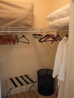 Large walk-in closet with extra pillows, blankets and robes for your convenience.
