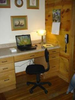 The kitchen desk is equipped with digital voice telephone and high speed cable internet.