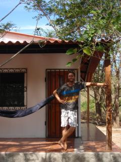 A guest about to enjoy an afternoon relaxing in a hammock.
